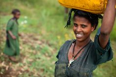 Many women in rural Africa walk up to four hours each day to collect drinking water. This woman, near Arekober, Ethiopia, used to walk more than an hour; now she has a well within a 15-minute walk from her house.