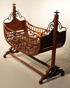 Friend of WXXI Antique Swinging Cradle: Beautiful open scroll work, ornate finials, & rows of spindles give the cradle timeless appeal.