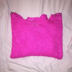 Hot Pink Reverse Studded Shoulder Sweater Worn once. Picture of the yellow sweater is for a better picture of how the pink would fit. All studs in tact. Please ask any questions you may have Reverse Tops