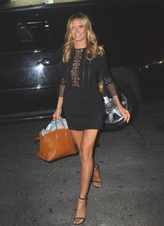 Heidi Klum was all leg in a tiny black minidress with a lace panel that exposed a touch of cleavage. (Photo by Raymond Hall/GC Images)  via @AOL_Lifestyle Read more: http://www.aol.com/article/2016/06/15/sexy-stars-emily-ratajkowski-charlotte-mckinney-and-more-flash/21395852/?a_dgi=aolshare_pinterest#fullscreen