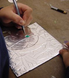 Has pictures with a step by step guide. Handy in a pinch, with limited resources or in between projects. I like the literature connection. Celtic art: illuminated letters using aluminum foil