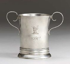 A SILVER TWO-HANDLED CUP -  MARK OF PAUL REVERE, PROBABLY JR., BOSTON, CIRCA 1775 -  Cylindrical, on circular foot, the body with slightly everted rim and two scroll handles, the body engraved with crest and monogram WHW, engraved under base with block initials HC, marked under base   3¼in. high; 3oz.