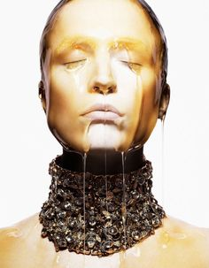 Alexander McQueenSpring/Summer 2013 Part of the Bee collection...honey dripping down the model's face.  the choker resembles a swarm...eeeeyyeeww.
