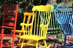 Love this for a patio. And all the chairs can be bought randomly from any second hand or Goodwill-type place on the cheap! The paint is from Benjamin Moore: Ruby Red, Orange Juice, Bright Yellow, Yellow Green, Brilliant Blue.