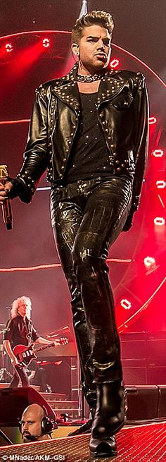 Leather outfits: Iconic Queen frontman Freddie Mercury, left, was known for his dramatic flair. Adam Lambert has been channeling the British singer on Queen's current tour