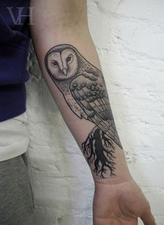 Really want an owl tattoo(: a delicate looking, pretty barn owl would be amazing!