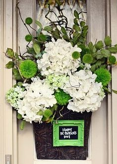 St. Patty's Day flowers, this would be great if you could use silk flowers so that you could reuse it every year