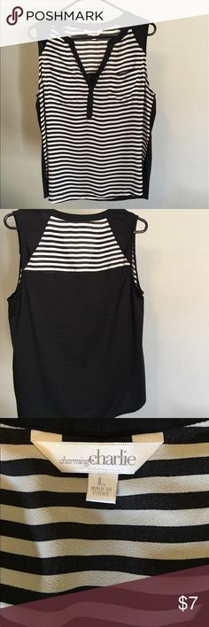 Charming Charlie tank top Black and white stripes, front pockets; no mistaking you for a referee! Charming Charlie Tops Tank Tops