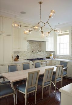 Interesting combination of materials and furniture.  Love the light fixture