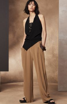 Inspired by masculine loungewear styles, these trousers boast subtle femininity with their soft shape. They sit high on the waist, and are perfect for both tucking in your top and leaving it out.