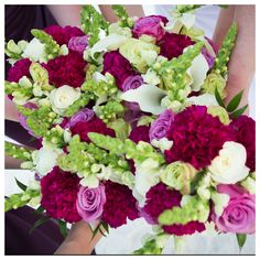 pink and purple bridal  party flowers destin florist beach wedding by Princess Wedding Co