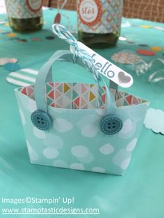Mini Tote Bag Tutorial To make this adorable project, cut a 6 x 6 inch piece of designer paper. Score it at 2 1/2, 3 and 3 1/2.