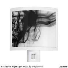 The Black Fire II Night Light designed by Artist C.L. Brown features fire photography converted to black and white. Now you don't have to be afraid of the dark! Light up any room with a one-of-a-kind night light to fit perfectly with your personality and décor. Type A plug, compatible with sockets in USA, Canada, Mexico and Japan. Designable area easily pops out and rotates to match electrical outlets with the ground pin at the top or bottom. A light bulb is included and the product…