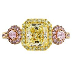1.67 Carat Fancy GIA Cert Yellow and Pink Diamond Gold Ring | From a unique collection of vintage three-stone rings at https://www.1stdibs.com/jewelry/rings/three-stone-rings/