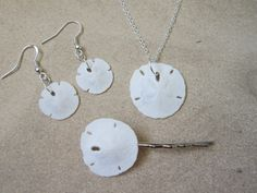 3pc White Sand Dollar Set - Earrings, Necklace & Hair Pin. $18.00, via Etsy. beach wedding accessories jewelry earrings necklace hair pin bracelet starfish nautical white real sand dollar shell hair clip comb pin sterling silver