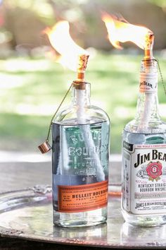 DIY Whiskey Bottle Tiki Torch .. Need Bottles with the same size opening as a beer or wine bottle, Tiki torch fluid, tiki torch wicks, and matches.