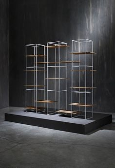 Ron Gilad has added a shelving system and oval table to his TT furniture collection, featuring surfaces that appear to hover unsupported in a metal frame. Cabinet Furniture, Metal Furniture, Furniture Design, Brutalist Furniture, Cube Furniture, Business Furniture, Furniture Online, Furniture Ideas, Outdoor Furniture