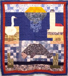 "Florida Manatee Lap Quilt 06 ""This quilt represents everything that comes to mind when I think of Florida-manatees, egrets, the lighthouse, and the sun."""