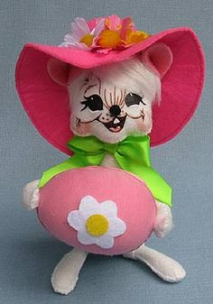 Doll Description: Open eyes, open mouth, white body and hair, pink hat with flowers, lime green bow, holds pink Easter egg with flower on it. http://www.suecoffee.com/2013-annalee-dolls.html