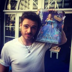 Richard Madden (Prince Charming) with the Cinderella doll ♥ sooo handsome ♥