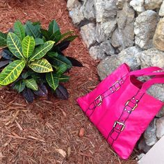 "❌ ! Beautiful hot pink shoulder bag ! Gorgeous color. Hot pink shoulder bag or even a beach bag. Material is faux leather. And has a picture of belts on it. Handles are 19"", 14.5"" tall and 16.5"" wide has a picket inside and a magnet closure Bags"