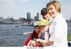 A family watching the celebration ceremonies during the anniversary festival of the port of Hamburg, Germany. - Stockbild