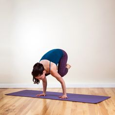 Crow:  If you notice a yogi's strong, sculpted arms, I'll bet money on the fact that she practices arm-balancing poses like Crow. This pose will also tone your abs.