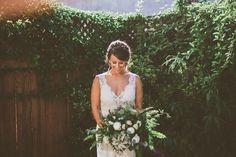 Airplant & fern bridal bouquet by San Diego wedding florist, Compass Floral.