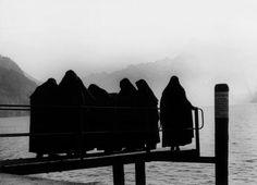 Nuns on a bridge, Switzerland 1950 (photo by Christer Strömholm)