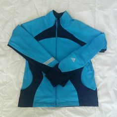 Adidas Climacool womens workout jacket Lightweight full-zip jacket has the Adidas logo on left sleeve. Two side zipper pockets and one small pocket on left sleeve. Mesh ventilation on the back and thump holes on the sleeves.  Two tone navy blue and light blue. This jacket has all the Climacool features. Adidas Jackets & Coats