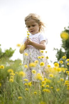 Jutta in a field of yellow flowers having the time of her life
