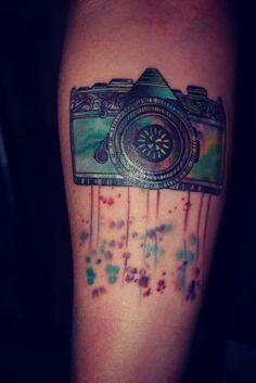 Watercolor Camera Tattoo ...i dont think id ever get it, but super cool!