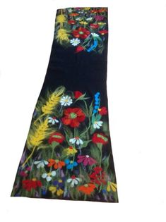 The shawl is made by highest quality of pre-felt containing 80% extra fine merino wool and 20% silk used as base for a nuno-felt wild flowers design. Dimensions: 210 cm length, 60 cm width Ask about available colours of prefelt. Personalised nuno felt design possible made after an image
