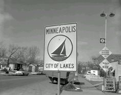 1957 - City of Lakes, Snelling Motel, and Highway Cafe Grill signs