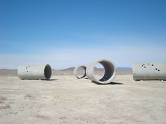 The Sun Tunnels are an earthwork by #artist #NancyHolt located in remote Lucin, Utah. On the summer and winter solstices, you can view the rising and setting sun perfectly framed through the massive concrete tubes.   #suntunnels #earthwork #landart #greatbasindesert #utah