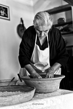 Nonna from Sardinia, old lady, baking, hands, focus, concentration, wrinckles, lines of life, wisdom, beauty, powerful face, strong, portrait, b/w