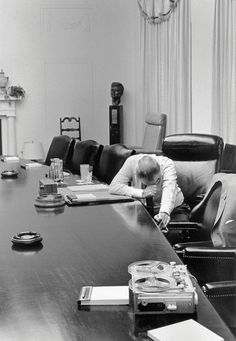 Photograph of President Johnson sitting at an empty conference table, his reaction to a tape sent to him by his son-in-law who was a US Marine in Vietnam. #military #history #US #vietnam #president #photography #bw #photograph