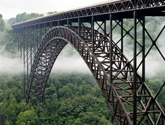 New River Gorge Bridge, West Virginia has some of the most beautiful bridges.  This one is lovely to behold.  When one is traveling over it, one has no idea how lovely it is.
