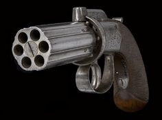 This bar-hammer type dating to the 1840s was the most common pepperbox pistol. It consisted of a cluster of barrels (here, six) bored from a single block, each with its own nipple. The cluster was rotated on an axial pin after each shot, bringing the next nipple into position under the hammer. Since the hammer blocked the line of sight, the gun was only accurate at point blank range.