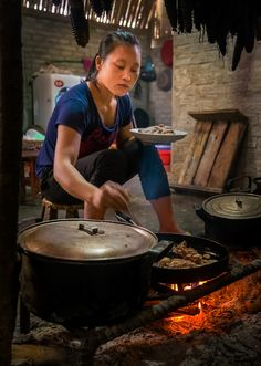 Red Dao woman cooking,Vietnam