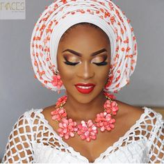 Biola stunned in Coral  @facesbylabisi  Aso Oke @bisbodv  Outfit @toshowoods #BellaNaijaWeddings