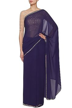 Kudi Pataka Designs Featuring a navy blue saree in bemberg georgette base with sequins work embroidery. It is paired with matching blouse in net base. Navy Blue Saree, Plain Saree, Engagement Dresses, Indian Embroidery, Pernia Pop Up Shop, Georgette Sarees, Prom Dresses, Formal Dresses, Saree Blouse
