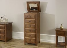 Our vanity chest has 5 traditional style drawers with an additional storage area at the top which is accessible from the pivoting bevelled glass mirror. Bed Furniture, Vanity, Furniture, Dresser As Nightstand, Bedroom, Glass Mirror, Small Bedroom, Bedroom Furniture, Handmade Bedroom Furniture