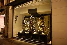 """Lance Armstrong's KAWS, Shepard Fairey, and Kenny Scharf """"Stages"""" bikes on display in Colette, Paris during Tour de France, 2009"""