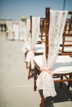 Fabric drape chair decor with peach ribbon. Carter Nendick Weddings & Events. Photography: Modern Vintage Weddings - www.modernvintageweddings.com  Read More: http://www.stylemepretty.com/little-black-book-blog/2013/12/04/elegant-rustic-italian-inspiration-from-carter-nendick-weddings-events/