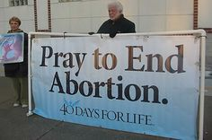 Pastor Arrested and Jailed for Holding Pro-Life Sign at Busy Intersection - Cross and Country