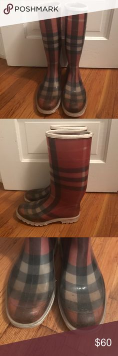 Vintage Burberry pink check Rainboots I am selling any pair of Burberry rainboots. I purchased them directly from Burberry years ago. They are obviously very worn on the tips and have scuffing and scratches throughout but are still a wearable pair of rainboots. I just do t have room for them in my closet anymore. They are a size 36. I am a true size 6. From the heel to the top of the shaft is about 13 inches. NO TRADES Burberry Shoes Winter & Rain Boots