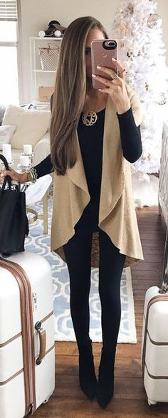 #winter #fashion / Light Vest / Black Top & Leggings & Booties https://bellanblue.com