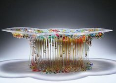 Ever wonder how real jelly fish look a like? Well here we bring you most beautiful glass table in the form of Jelly Fish. Italian artisan Daniela Glass work uses a unique process to create stunning glass Sculptures which looks like a sea creature.   #Dripping Glass Table Jellyfish Sculptures #Jellyfish Sculptures