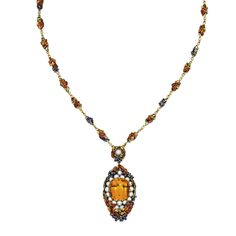Gold, Citrine, Pearl and Enamel Pendant-Necklace, Tiffany & Co., Designed by Louis Comfort Tiffany  Supporting an oval-shaped pendant centering a cushion-cut citrine within a pearl frame, bordered by leaves and grape clusters highlighted in autumnal hues of orange, gold, green and purple, the reverse of the pendant designed as a bird's nest decorated with enameled leaves, suspended from a foliate chain of similar design, accented by two additional pearls,